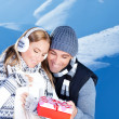Happy couple outdoor at winter mountains - Stock Photo