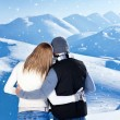 Happy couple hugging outdoor at winter mountains, rear view — Stock fotografie