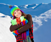 Happy girl with Christmas gift, winter outdoor portrait — Stock Photo
