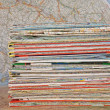 Stack of various travel maps — Stock Photo #7495723
