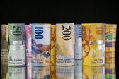 Swiss franc rolls — Stock Photo