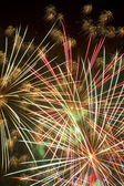 Fireworks beautiful bright colors and shapes — Stock Photo