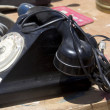 Stock Photo: A very old black telephone