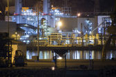 Petrochemical refinery at night with full moon light — Stock Photo