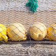 Fishing tackle net detail with yellow buoy — Stock Photo