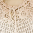 Crochet white woman shirt in white with thread loop - Stock Photo