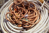 Aged ropes from fishing tackle stuff — Stock Photo