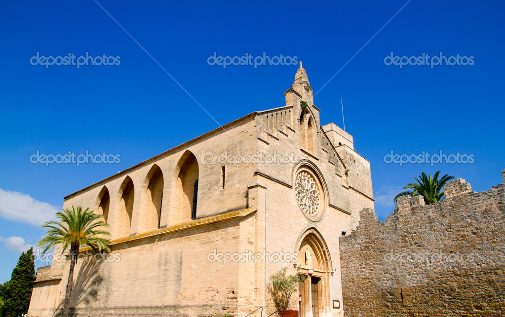 Alcudia Sant Jaume church near roman castle wall Mallorca island in Balearic Spain  Stock Photo #6822760
