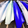 Beach colorful kayak rows lying on sand in sunny day - Foto Stock
