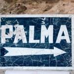 Aged blue road sign with arrow to Palma de Majorca — Stock Photo #6836573