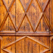 Aged golden wood door from Lonja of Palma de Majorca - Stock Photo