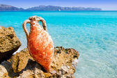 Alcudia Beach Mallorca with roman amphora — Stock Photo