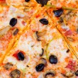 Closeup of pizza with olives tomato cheese — Stock Photo #6916885