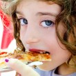 Blue eyes child girl eating pizza slice — Stock Photo