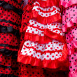 Red pink gipsy costumes of flamenco dancer — Stock Photo