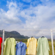 Royalty-Free Stock Photo: Fashion outdoor market with clothes hanging