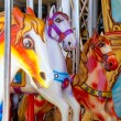 Horses in merry go round fairground — Stock Photo