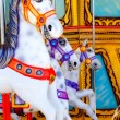 Stock Photo: Horses in merry go round fairground