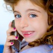 Child girl indented talking mobile telephone - Stock Photo