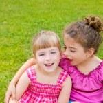 Children girls hug in green grass park — Stock Photo #6947347