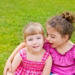 Children girls hug in green grass — Stock Photo #6947356