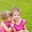 Children girl sister friends whispering ear — Stock Photo