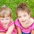 Two sister children girls happy in the grass — Stock Photo #6947402