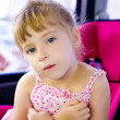 Blond child girl sitting in car safety seat — Foto Stock