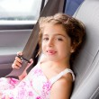 Child little girl indoor car putting safety belt — Stock Photo #6947452