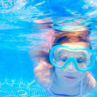 Blond child girl underwater swimming in pool - Stock Photo