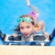 Stock Photo: Blond little girl in swimming pool with goggles