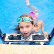 Blond little girl in swimming pool with goggles — Stock Photo