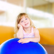 Child little girl with gym aerobics ball — Stock Photo #6947499