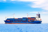 Cargo ship with containers in dep blue sea — Stock Photo