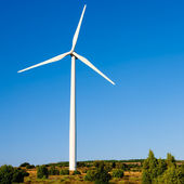 Aerogenerator windmill in sunny blue sky — Stock Photo