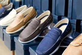 Classic man shoes colorful in a row — Stock Photo