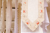 Embroided warm tablecloth with flowers — Stock Photo