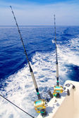 Boat fishing trolling in deep blue sea — Stock Photo