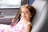 Child little girl indoor car putting safety belt — Stok fotoğraf