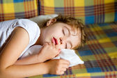 Child girl sleeping bed in retro vintage quilt — Stock Photo