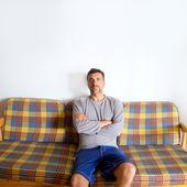 Retro mustache man sitting in vintage sofa — Stock Photo