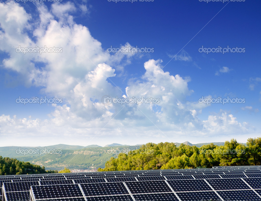 Green energy solar plates to provide mountain valley village  Stock Photo #6945659