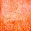 Grunge wall cracked texture in orange — Stock Photo