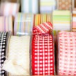 Fabric tapes reels in haberdashery of vichy - Stock Photo