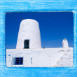Blue wood frame with Formentera windmill — Lizenzfreies Foto
