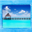 Blue wood frame with Caribbean beach — Stock Photo