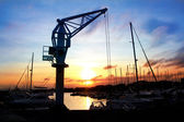 Dock crane port sunset in Salou Tarragona — Stock Photo