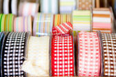 Fabric tapes reels in haberdashery of vichy — Stock Photo