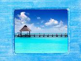 Blue wood frame with Caribbean beach — Stock Photo
