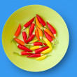 Colorful chili peppers plate isolated - Stock Photo